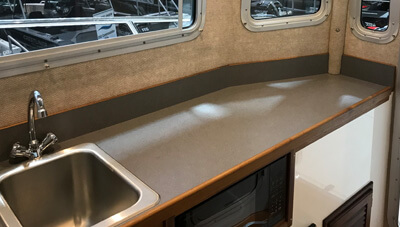 Osprey-Pilothouse-28-LongCabin-More-Living-Space-3-1559232260692.jpg