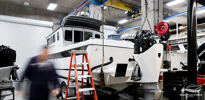 APM-Facilities-Shop-Crane-on-chain-Mercury-Coldfusion-Powering-SeaSport-Boats-busy-person-1590754827313.jpg
